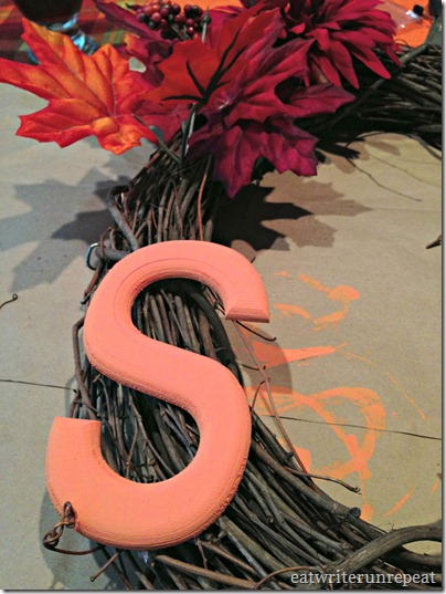 monogrammed fall wreath placing the S